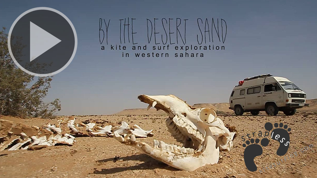 by the desert sand